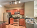 The fully equipped kitchen features stainless steel appliances & granite counters.