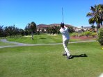 Play a round of golf at the Golf Las Americas