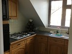Separate fully fitted kitchen. with plates utensils/pans etc.Everything for cooking.