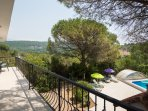 large terrace overlooking the pool (can be accesses from both bedrooms and the living room)