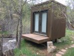 Find some peace and quiet in our Meditation hut by the river