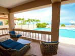 Spacious oceanfront patio with comfortable outdoor lounging furniture