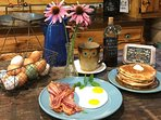We furnish your pound of Hickory Smoked Bacon, Organic Free Range Eggs, Moonshine Syrup & MORE!