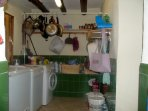 Utility room next to kitchen.Washing machine,dish washer and chest freezer.