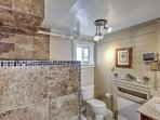 The pristine bathroom features a beautiful walk-in shower.