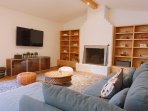 Living room with gas fireplace, 55' smart tv (Roku) with AppleTV.
