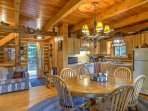 The dining table set for 6 shares this space as well as the well-equipped kitchen, making it easy to whip up a...