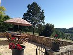 The lovely sunny terrace has far reaching views over the valley to St Cernin de Labarde