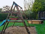 Relax on our rear garden patio overlooking the play area and swing-set