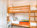 Twin room with adult size bunk-beds.