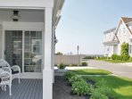 Relax on the covered porch - the beach is just 2 doors down! - 5 Sea Breeze Avenue Harwich Port Cape Cod - New England...