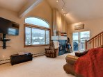 Awesome living/lounging area with fireplace, flat screen and adjacent to dining area.