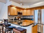 Well appointed kitchen with coffee maker, toaster, blender, slow cooker and more.