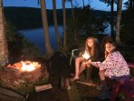 Campfire, loons, sparklers, samoas, while making family memories on peaceful Pleasant Pond.