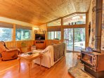 The beautiful cabin-style home features pine ceiling and pine trim throughout, along with a wood stove mounted against...