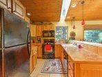 The kitchen features a beautiful skylight and ample counterspace to whip up home-cooked masterpieces.