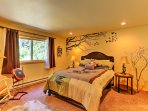 The master bedroom has a queen-sized bed and a large walk-in closet.