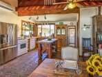 Stainless steel and new appliances are featured in this fully-equipped kitchen.