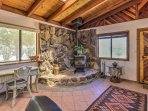 The stone hearth adds to the rustic atmosphere of the home.
