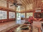 A large rec-room features amazing woodwork by a master craftsman.