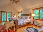 The master bedroom features a king bed, access to one of the multiple porches, and a spacious en suite bathroom.