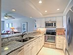 Prepare delicious meals in the fully equipped kitchen, complete with gorgeous granite countertops.