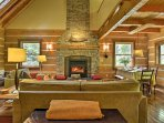 Warm yourself by the wood-burning fireplace in the living room with 2 plush couches, cathedral ceilings, and a gorgeous...