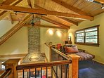 The loft area offers additional sleeping with a full-sized futon.