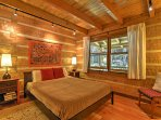 The second bedroom exemplifies the cabin feel with a queen-sized bed.