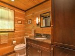 The guest bathroom is the perfect blend of rustic cabin with modern touches.