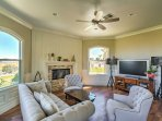 In the living room, you'll love sinking into the plush furniture as you relax by the fire.
