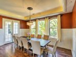 Gather around the dining table to share meals and beverages.