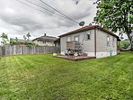 The home offers a spacious, fenced-in yard, perfect for the kids and pets.