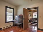 From the living room, make your way into the second bedroom with a vintage piano, large book case, and queen-sized...