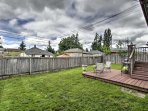 The spacious, fenced in backyard is perfect for kids or your furry friend to run around all day.