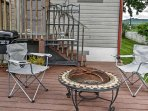 The patio offers a fire pit and gas grill.