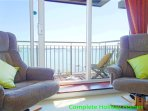 With swivel recliners overlooking the water