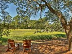 Sip your favorite beverage on 2 Adirondack chairs and take in the peaceful views.