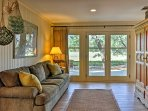 Natural light pours into the sitting room from wall-to-wall windows.