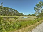 Savor the scenic drive through marshy wetlands as you approach the home.