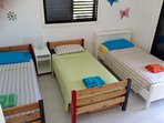 2nd bedroom with 3 single beds