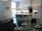 Open plan living and dining with a contemporary and eye catching kitchen