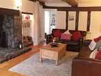 Spacious lounge with inglenook fireplace