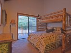 The third bedroom has a bunkbed with one twin bed and one full bed, plus access to a balcony.