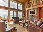 Relax in the family room that boasts floor-to-ceiling windows, cathedral ceilings, a stone, gas fireplace, plush...