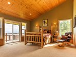 This spacious bedroom offers a plush queen bed, balcony access, and an en suite bathroom.
