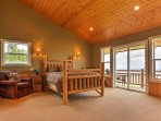 This bedroom also features a queen bed, balcony access, and an en suite bathroom.