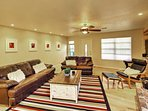 The inviting living room features leather furniture, a fireplace and flat-screen Smart TV with a Blu-Ray player.