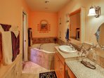 Soothe your muscles in this Jacuzzi bathtub from the en-suite bathroom of the master bedroom.