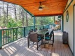 Gather around the outdoor table for an al fresco dining experience.